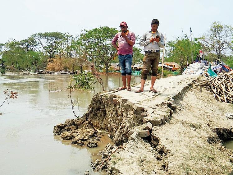 The damaged dam over the Goureshwar river at Hingalganj in North 24-Parganas that inundated Rupmari village on Sunday night.