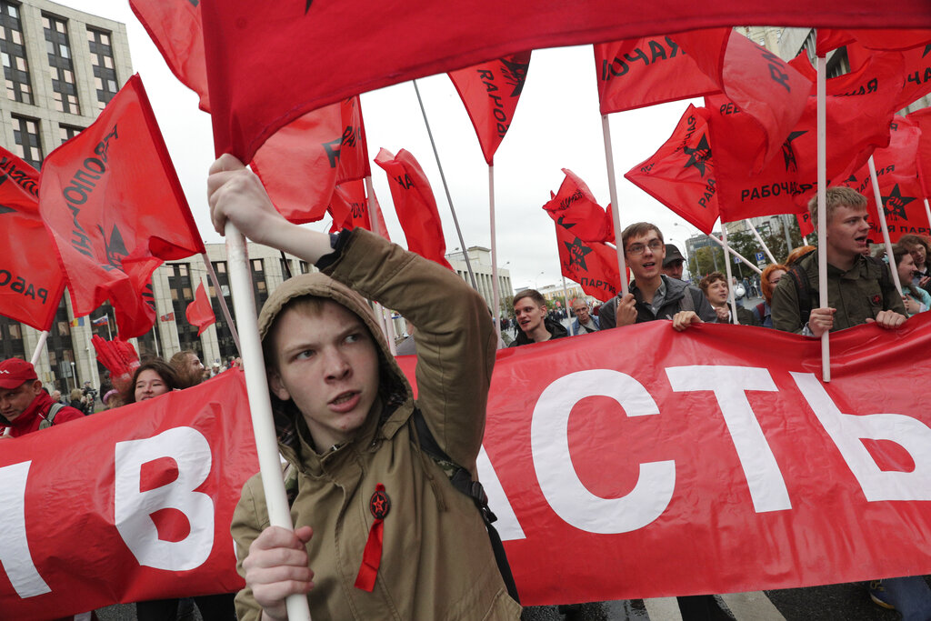 In this file photo, Communist party supporters wave red flags during a protest in Moscow on August 17, 2019. A seemingly second-tier local election has evolved into a major challenge to Vladimir Putin, triggering the biggest protests against his rule in seven years and causing divisions among his top lieutenants.