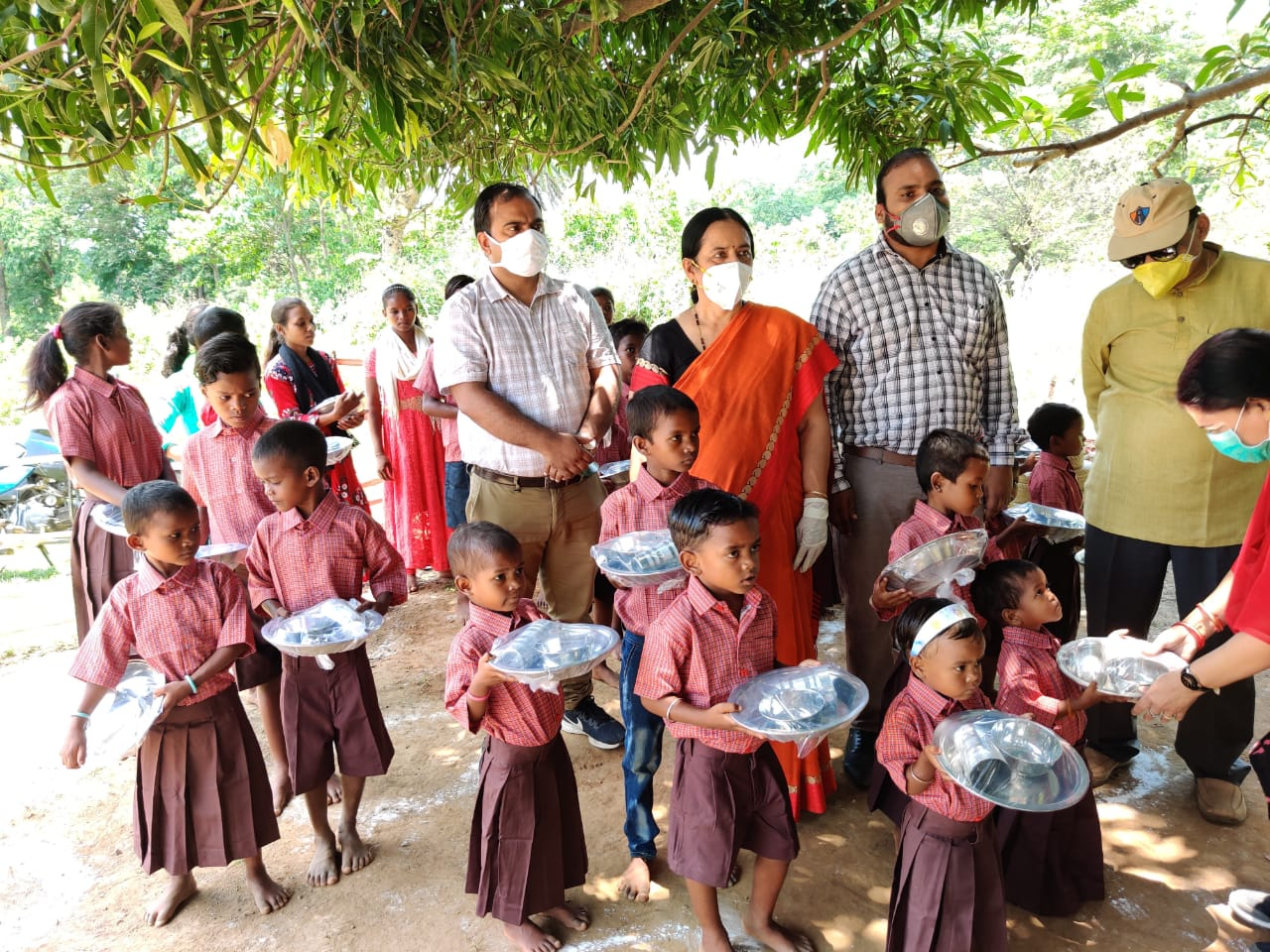 Food being served to Sabar children at a village in Saraikela-Kharsawan district as part of the Palash ke Phool initiative