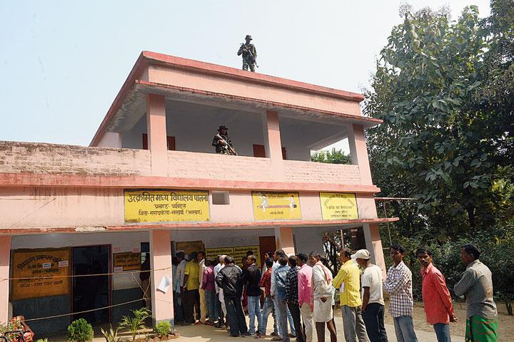 Voters queue up at Utkramit Madhya Vidyalaya in Palna.