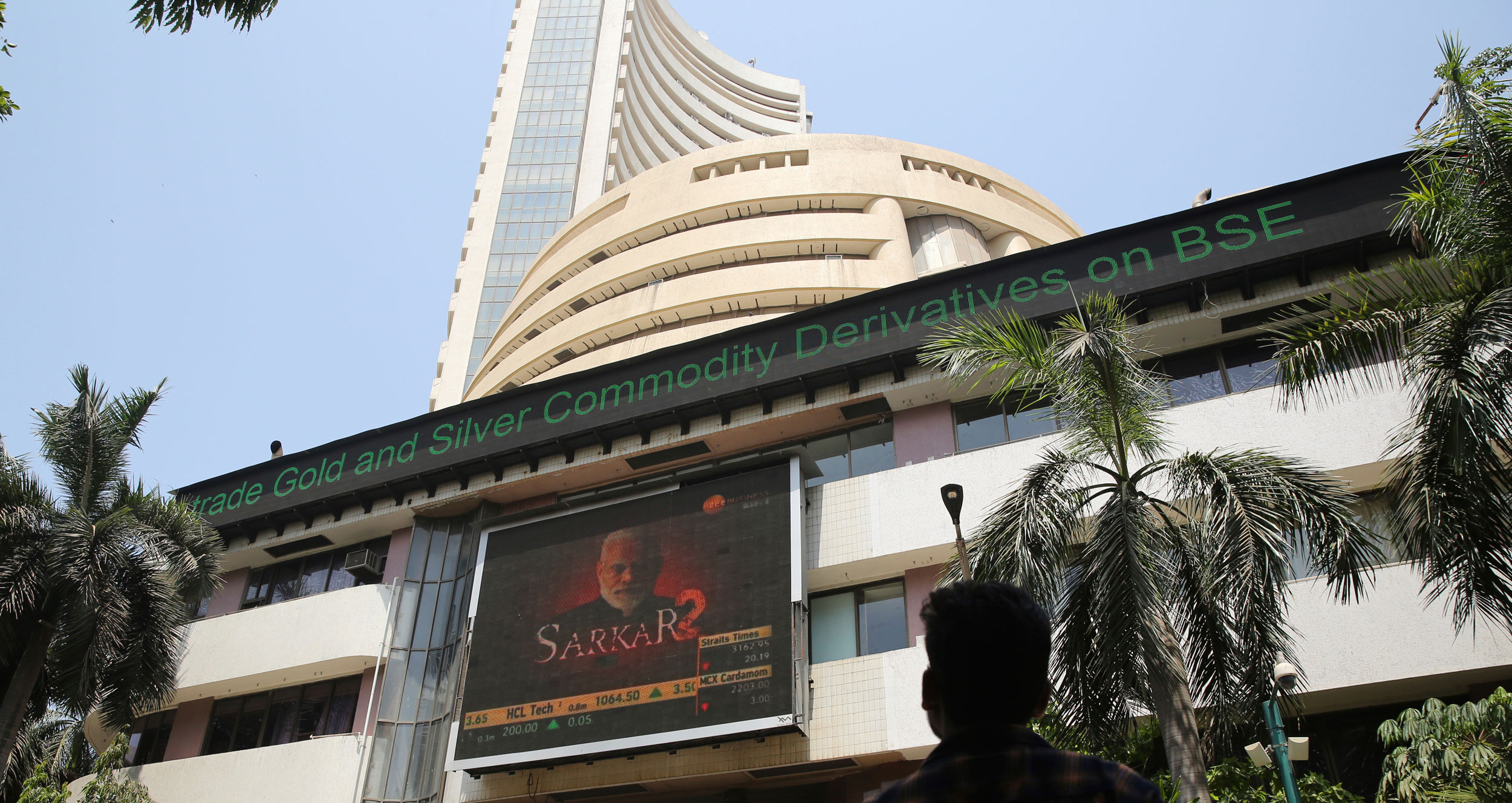 A man watches Indian stock market indices on a display screen on the facade of the BSE building in Mumbai, on May 23, 2019.