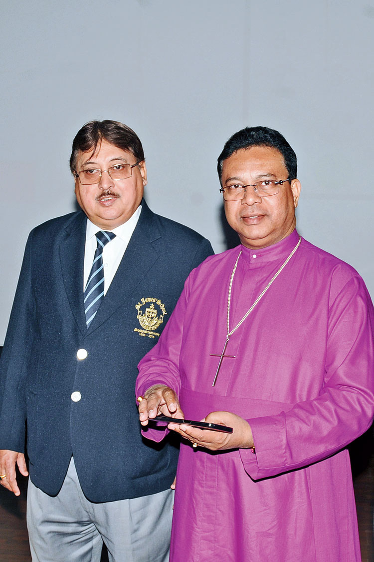 Principal of St James' School Terence Ireland and (right) bishop Paritosh Canning at the launch on Wednesday.
