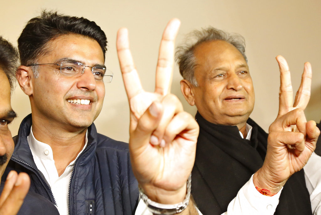 Congress leaders Sachin Pilot (left) and Ashok Gehlot celebrate their party's victory in Jaipur on Tuesday.