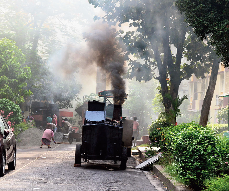 A hot mix plant belches smoke in Cluster II, Purbachal on Wednesday