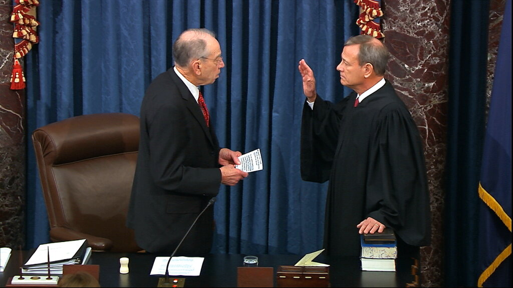 President Pro Tempore of the Senate Sen. Chuck Grassley, R-Iowa., swears in Supreme Court Chief Justice John Roberts as the presiding officer for the impeachment trial of President Donald Trump in the Senate at the U.S. Capitol in Washington, on January 16, 2020.