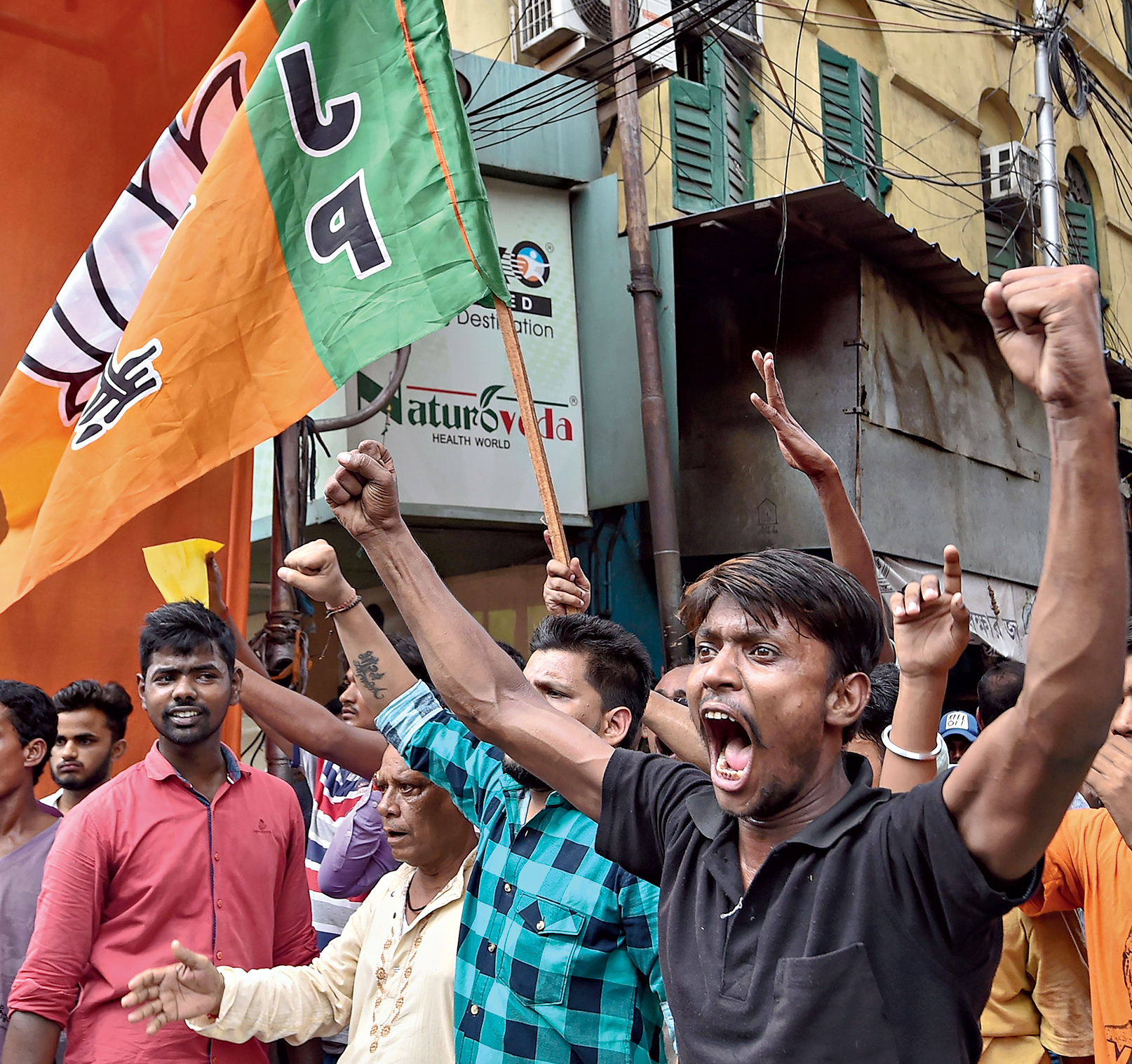 BJP supporters shout slogans during a protest in Calcutta on Sunday after the political murders in Sandeshkhali.