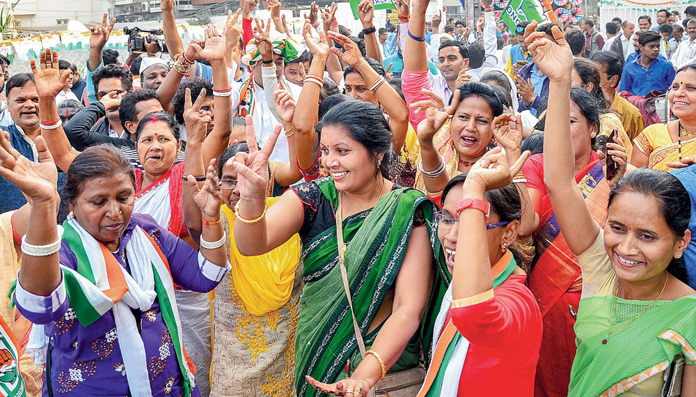 Congress workers celebrate in Raipur, Chhattisgarh, on Tuesday.
