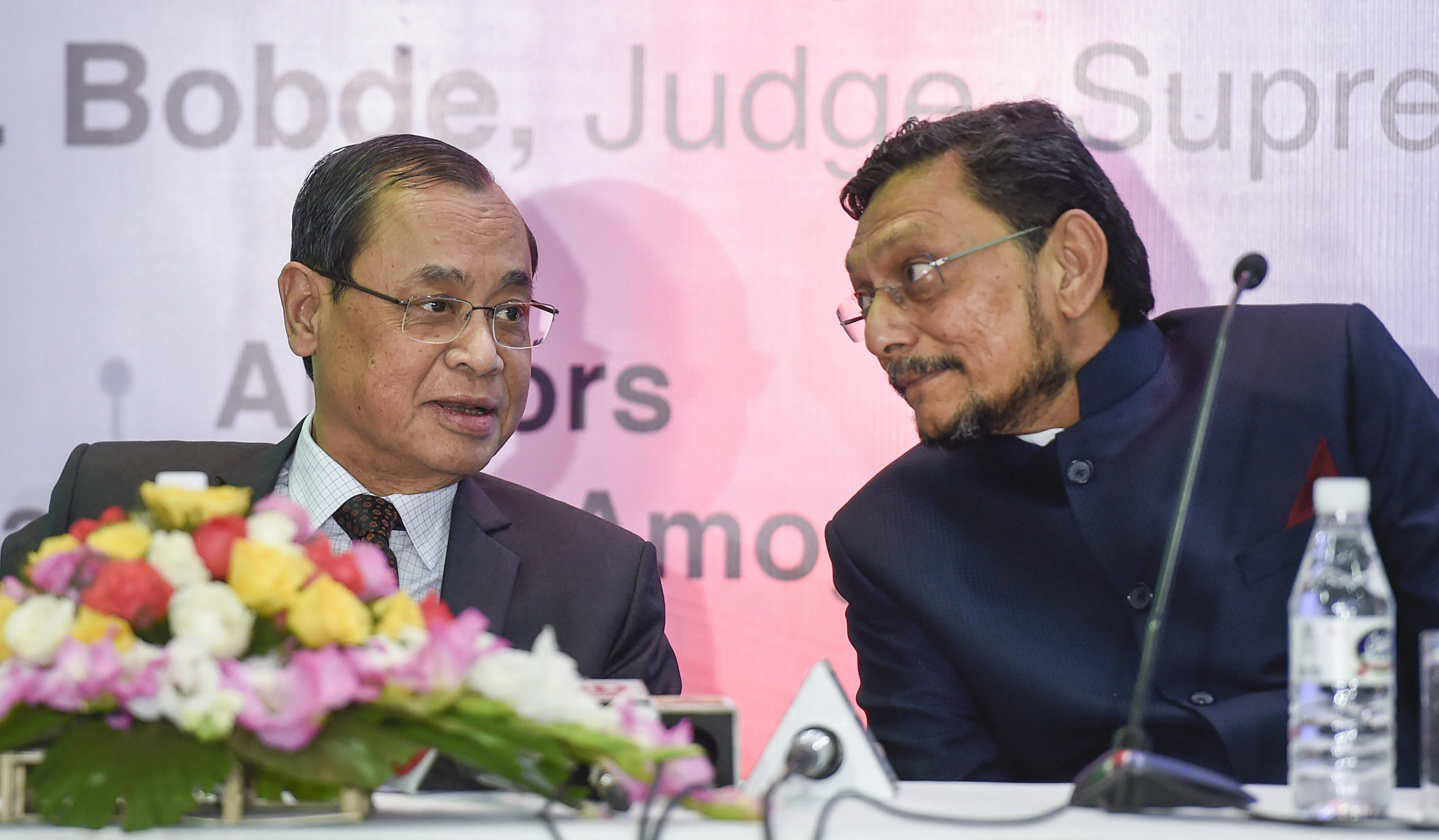 In this Friday, November 30, 2018, file photo, Chief Justice of India Ranjan Gogoi (left) speaks with Justice S. A. Bobde (right) in New Delhi