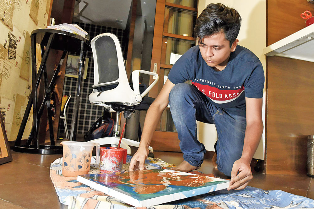 Harshit busy with work in his room-cum-studio
