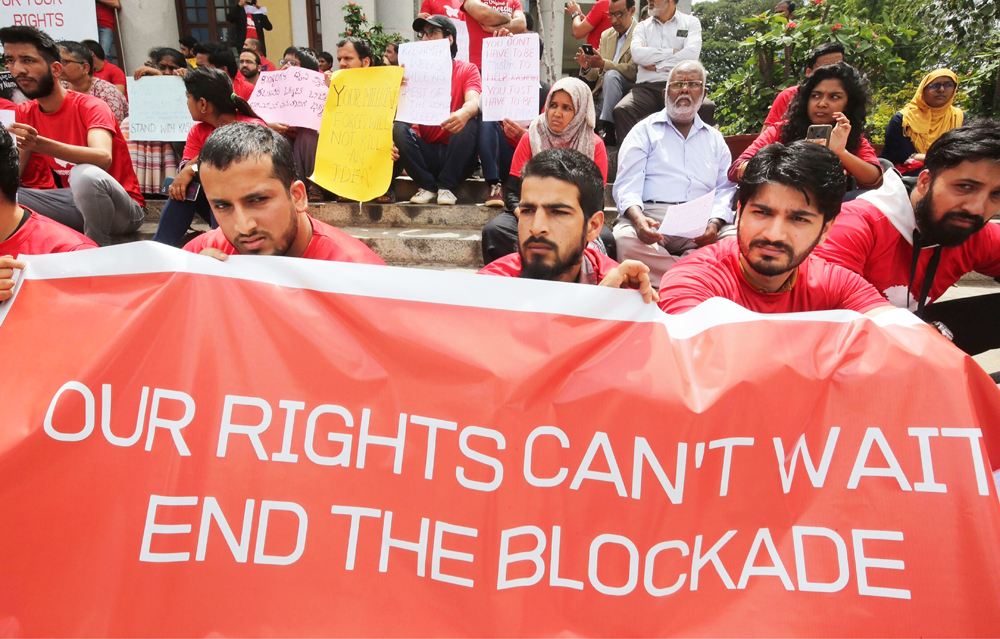 Kashmiris living in Bangalore during a protest against the blockade of communication in Kashmir, in Bangalore, Saturday, August 24, 2019.