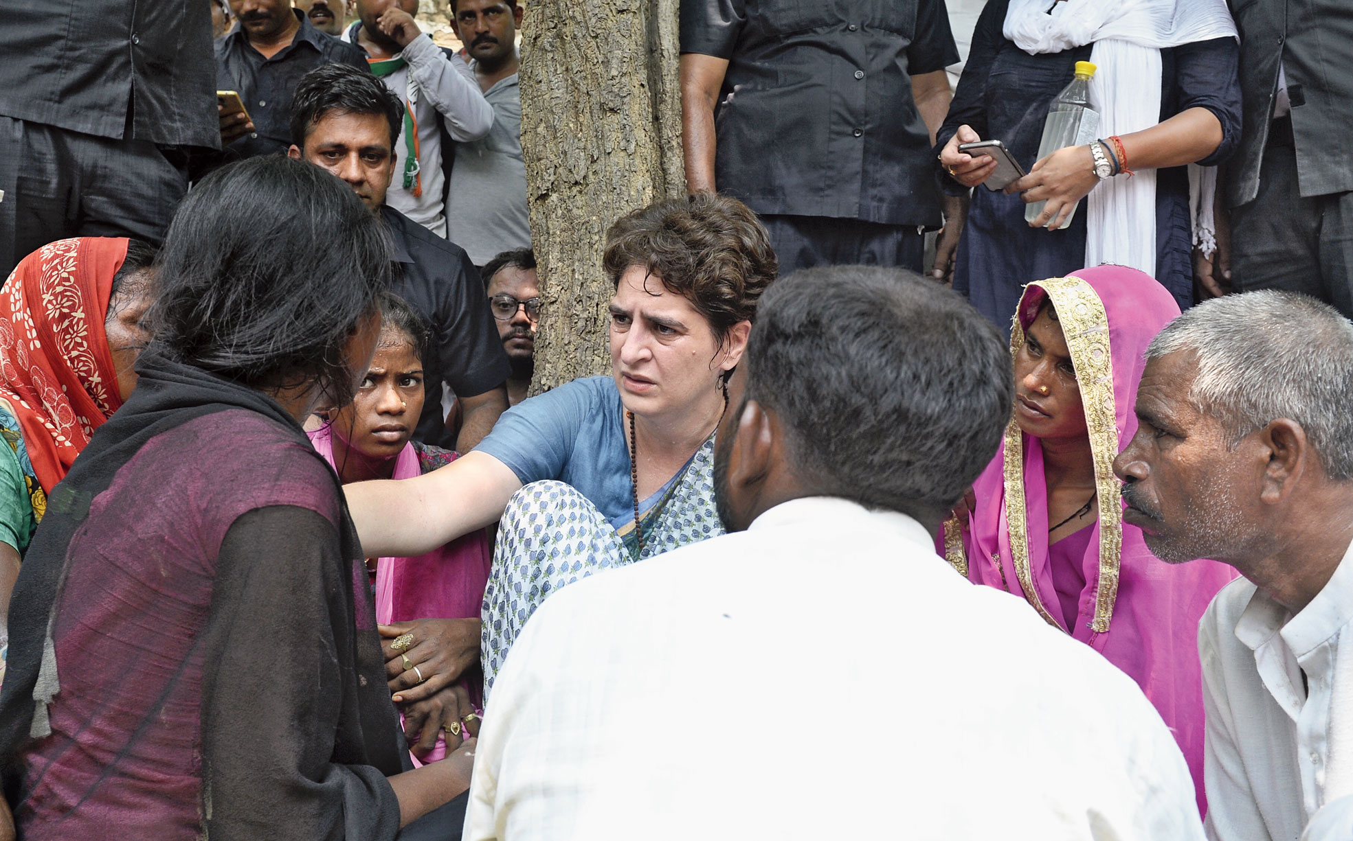 Priyanka Gandhi Vadra on Saturday with family members of the slain Umbha residents.