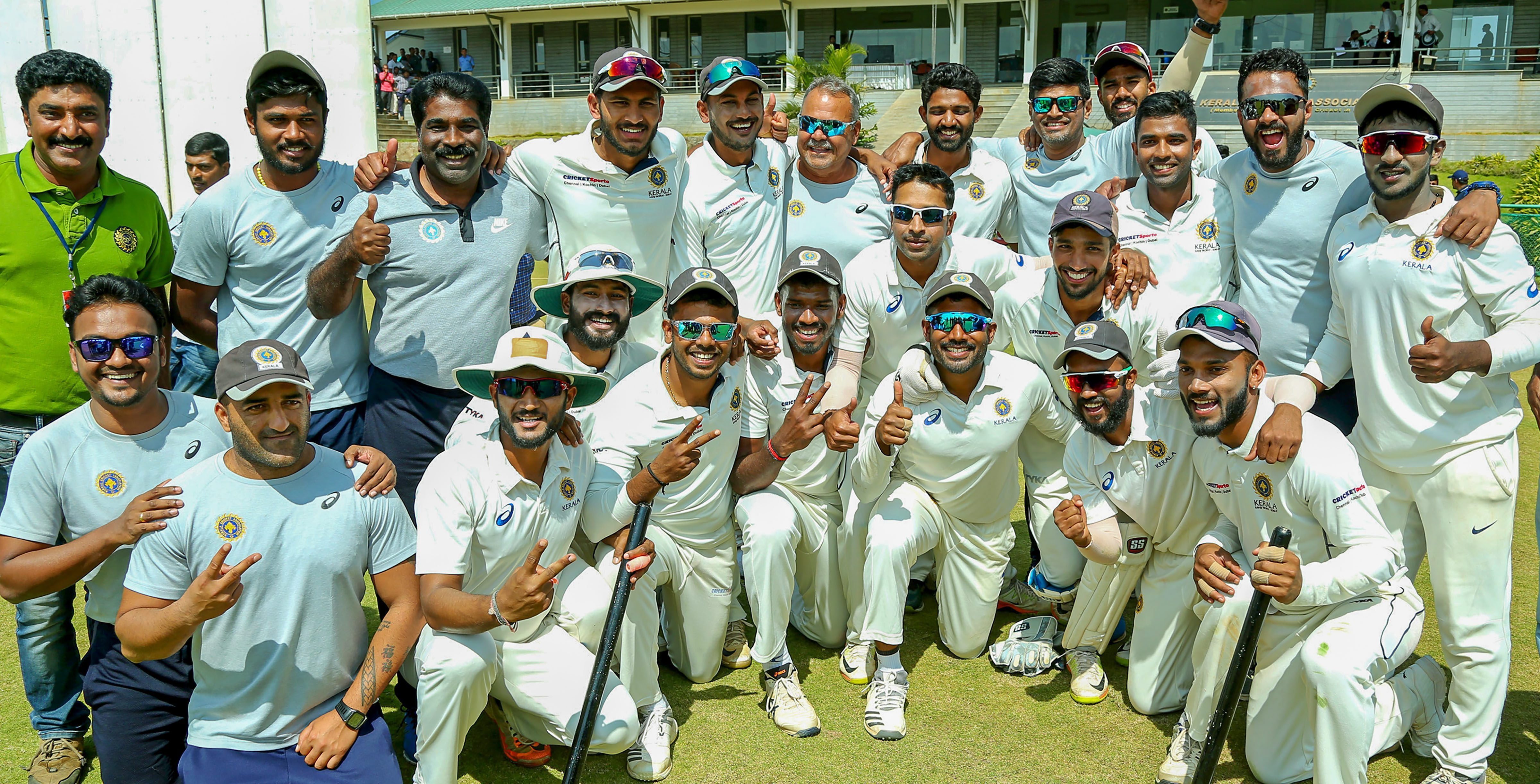 The Kerala team poses for photographs after winning against Gujarat in Wayanad on Thursday.