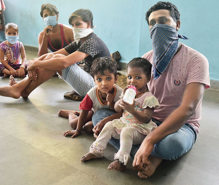 Migrant workers take refuge at a municipal school  in Thane on Wednesday.