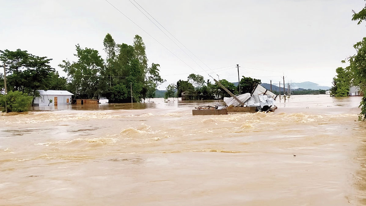 Floodwaters inundate Bapurvita area of Lakhipur in Goalpara district.