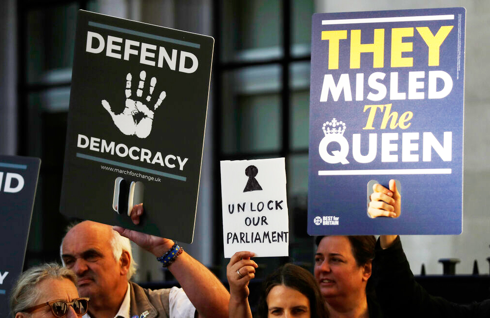 Protesters hold banners outside the Supreme Court in London last week