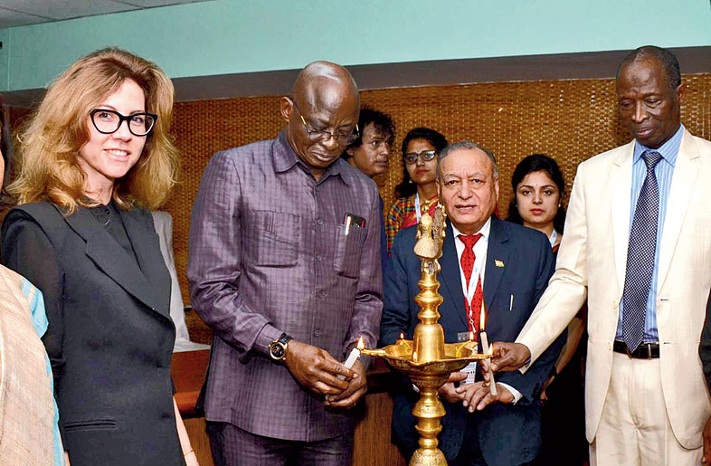 H.E. Maj General Chris Sunday Eze, the high commissioner of Nigeria to India, lights the inaugural lamp at the trade fair in Guwahati on Friday