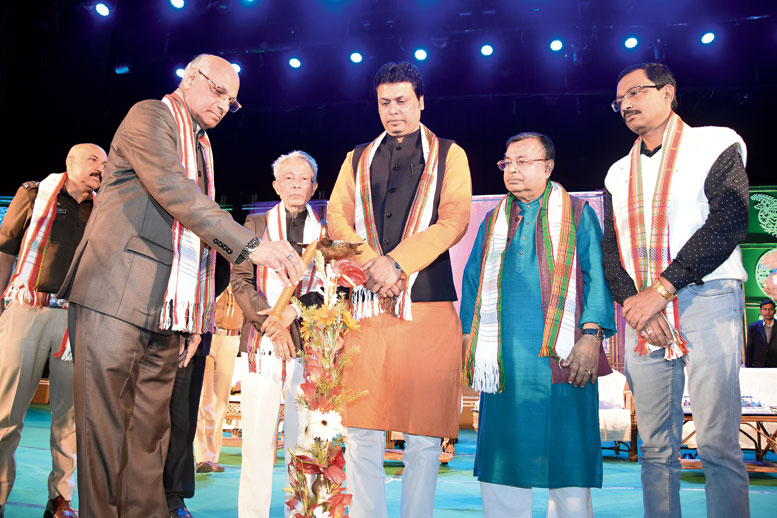 Tripura governor Ramesh Bais lights the inaugural lamp of the event in Agartala on Tuesday as chief minister Biplab Kumar Deb looks on