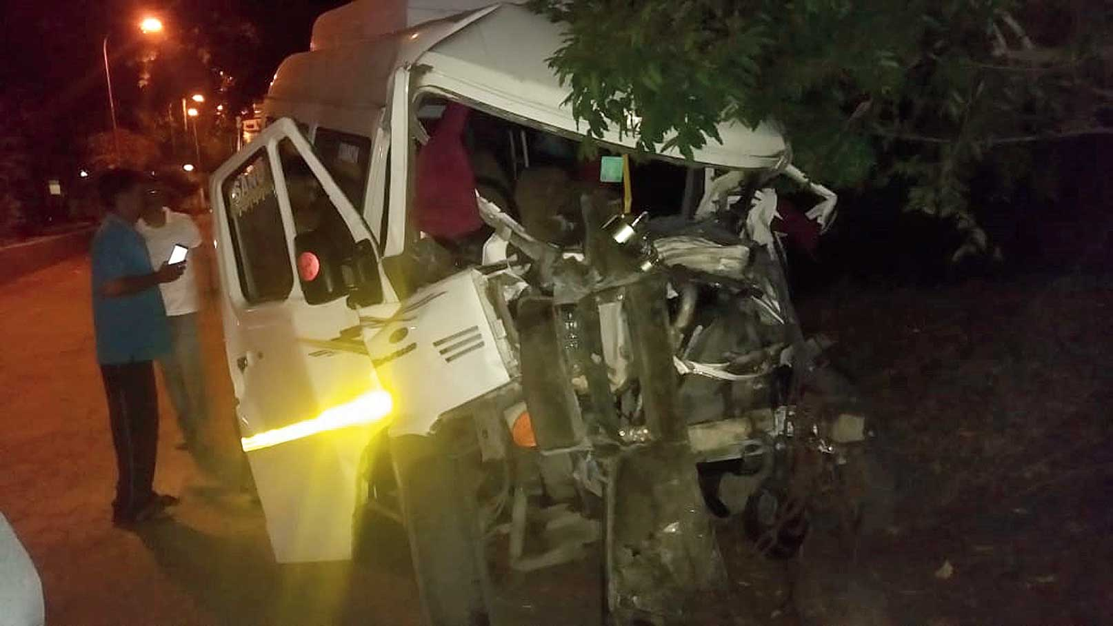 The mangled Tempo Traveller after the accident.