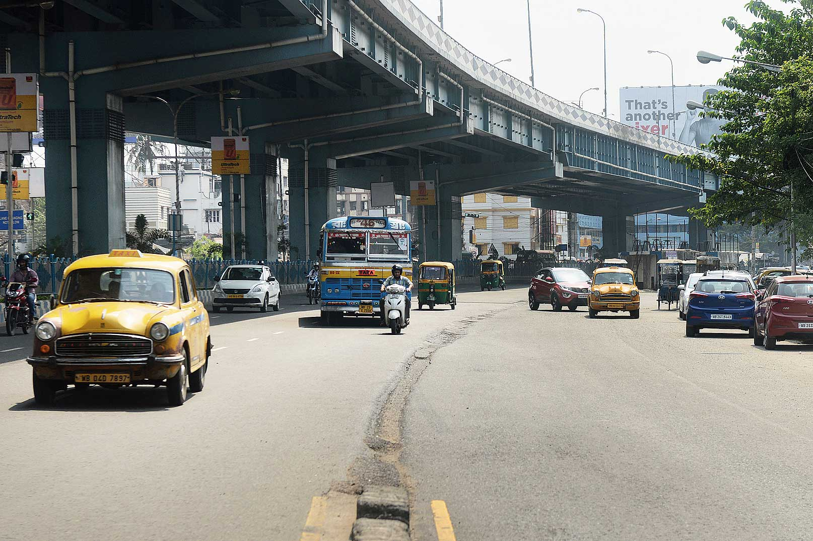 Autos are supposed to ply down the service lane (right) of VIP Road, a rule that is flouted every day near the Baguiati bus stand.