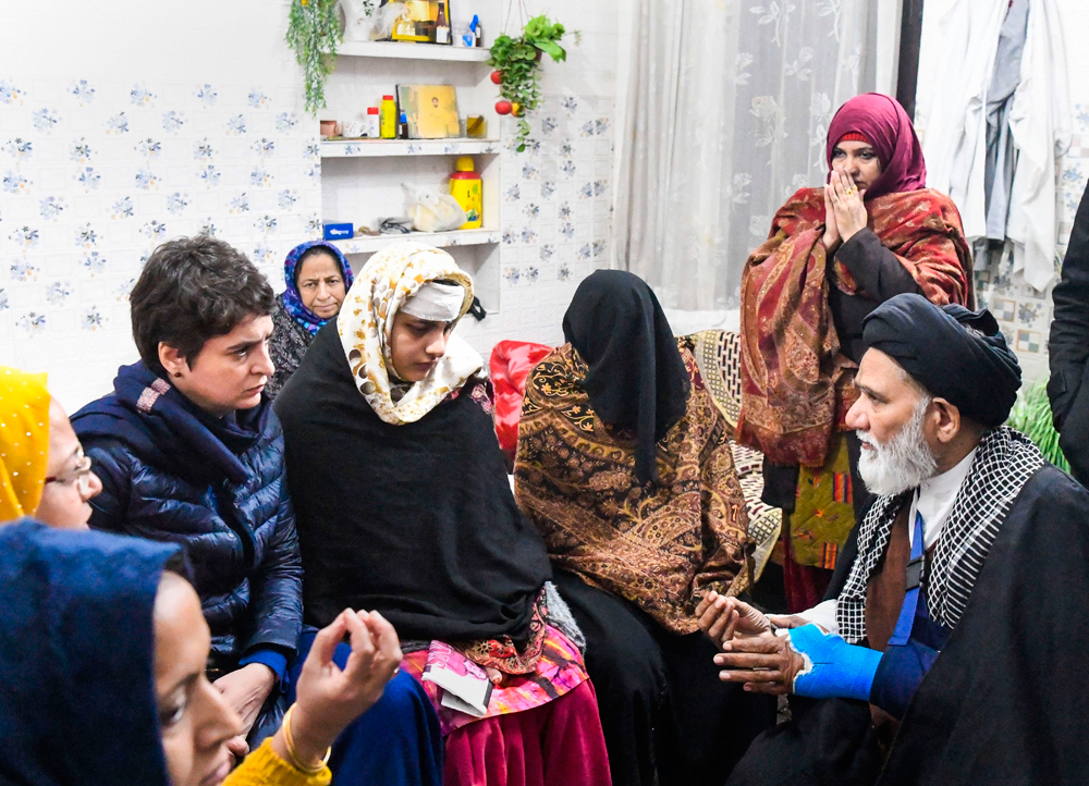 Priyanka Gandhi Vadra with Ruqaiya Parveen, whose house was allegedly ransacked by police during violence that erupted following anti-CAA protests, in Muzaffarnagar on January 4