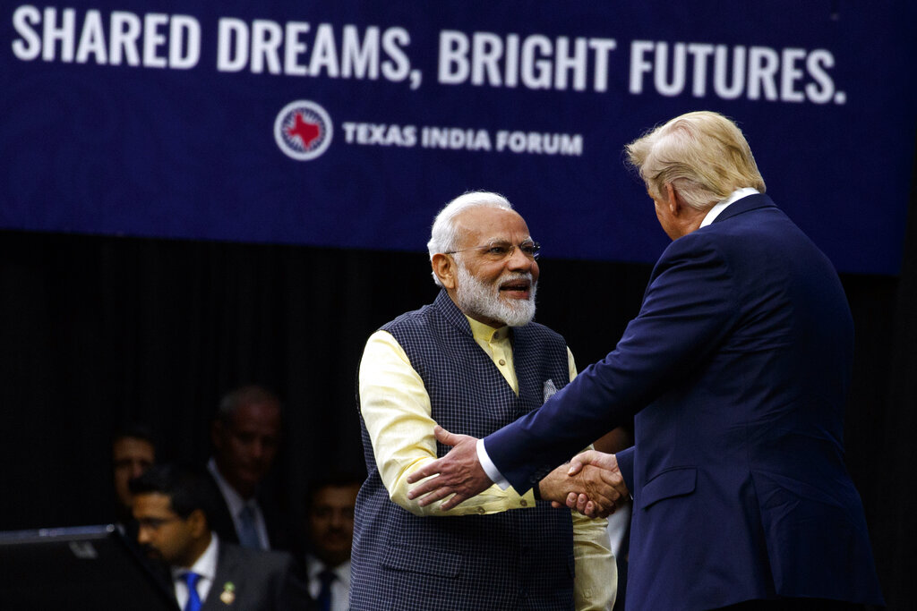 US President Donald Trump shakes hands with Prime Minister Narendra Modi during the