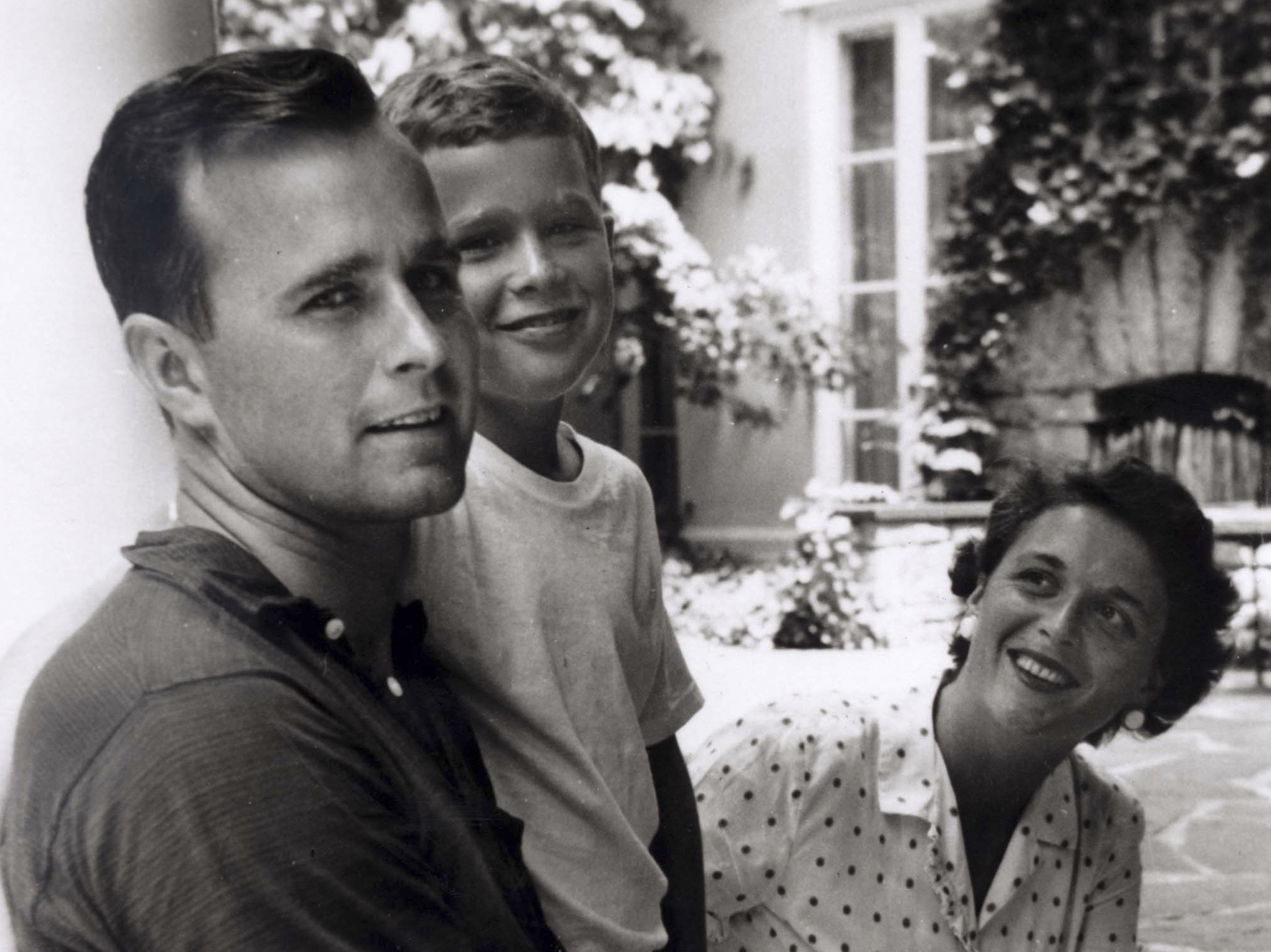 This undated handout photo shows Bush with his son George W. Bush and wife Barbara.