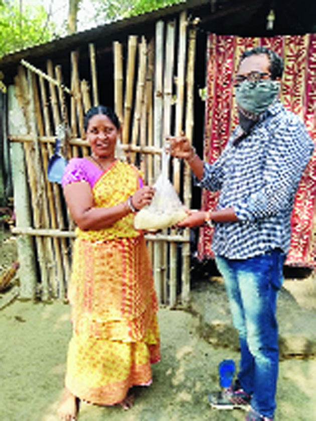 A woman gets ration bought with funds raised by IIT Kharagpur students
