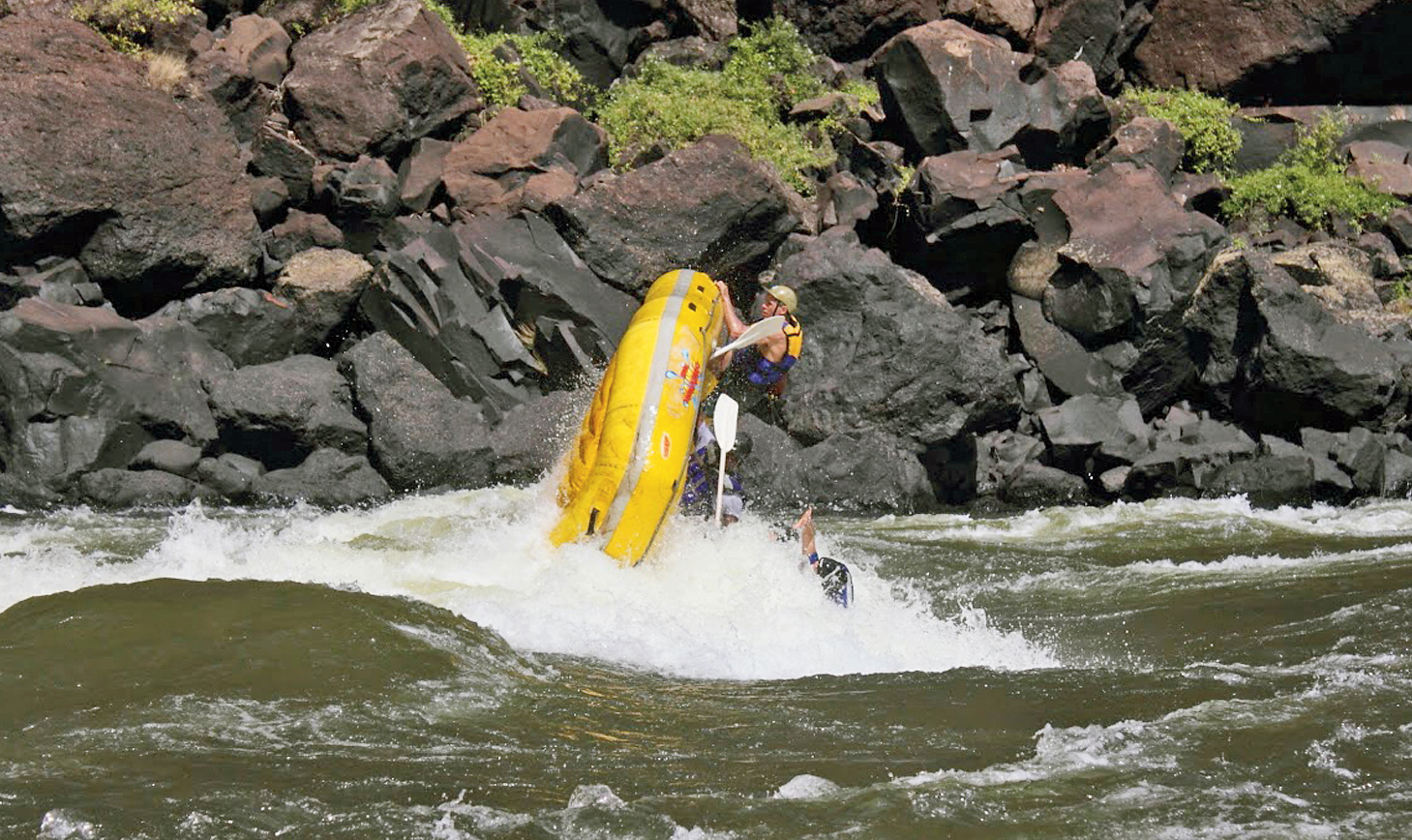 Pal's raft topples over in the Zambezi river. The picture was taken from another raft