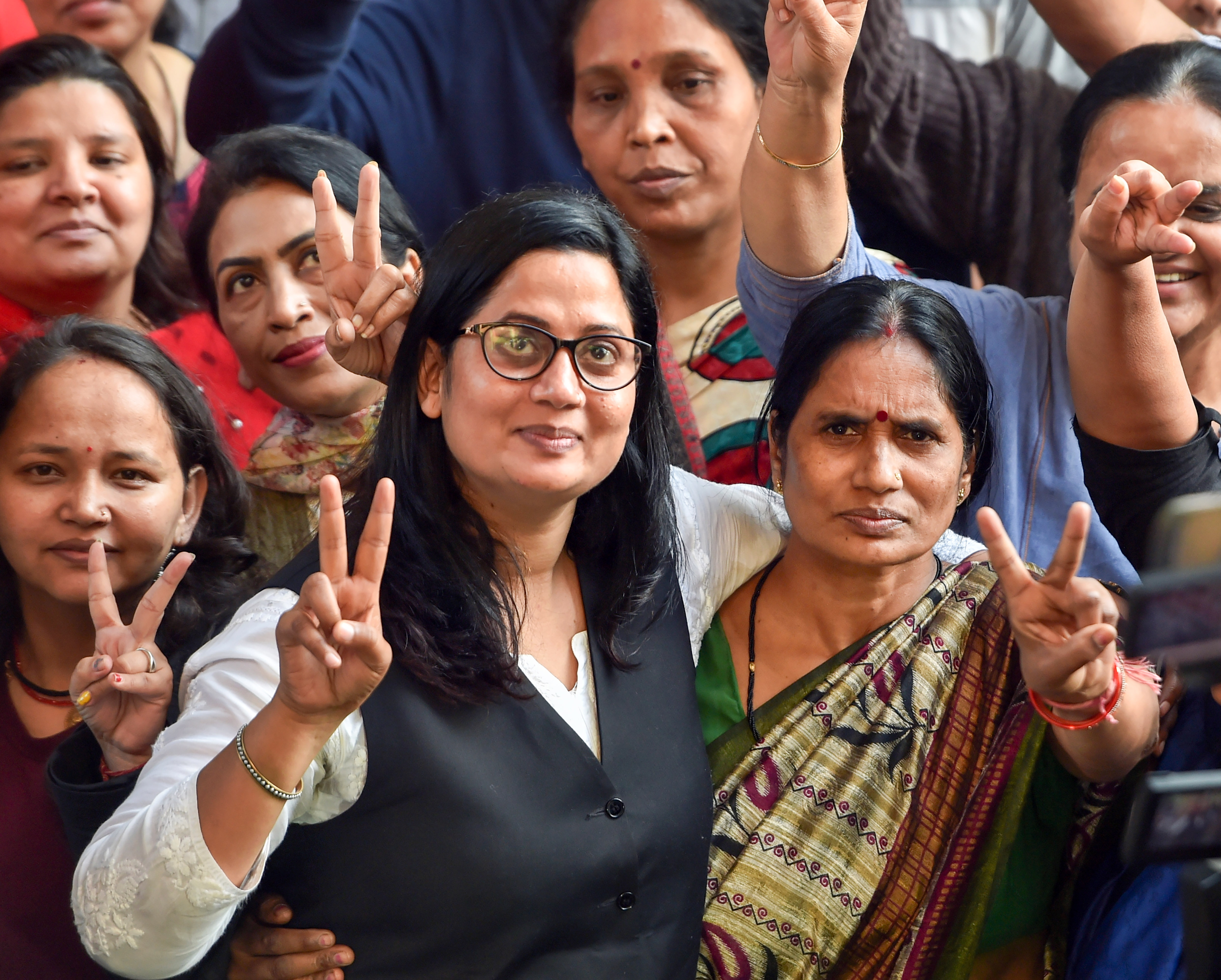 Nirbhaya rape and murder case victims mother (R) with her lawyer Seema Kushwaha gesture after four men convicted of the crime were executed inside Tihar jail, in Dwarka, New Delhi, Friday morning, March 20, 2020.