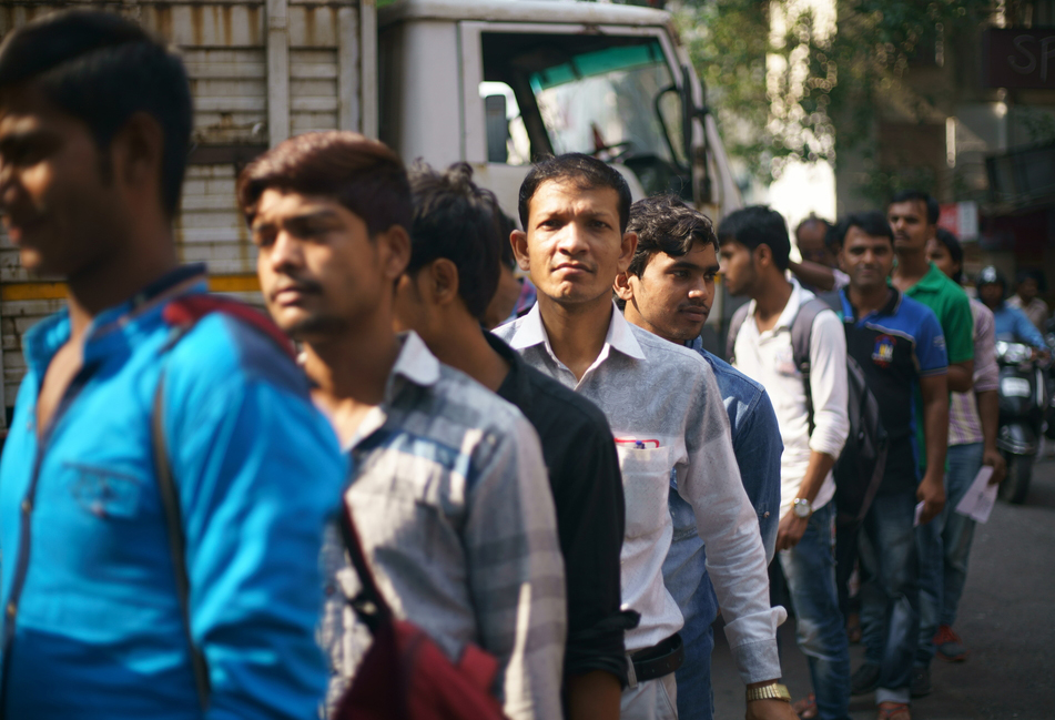 Workers standing in line outside a construction site for their daily wage in Mumbai. The centre appointed committee has suggested that the minimum wage should not be less than Rs 375 for work done for the government, private establishments and individuals.