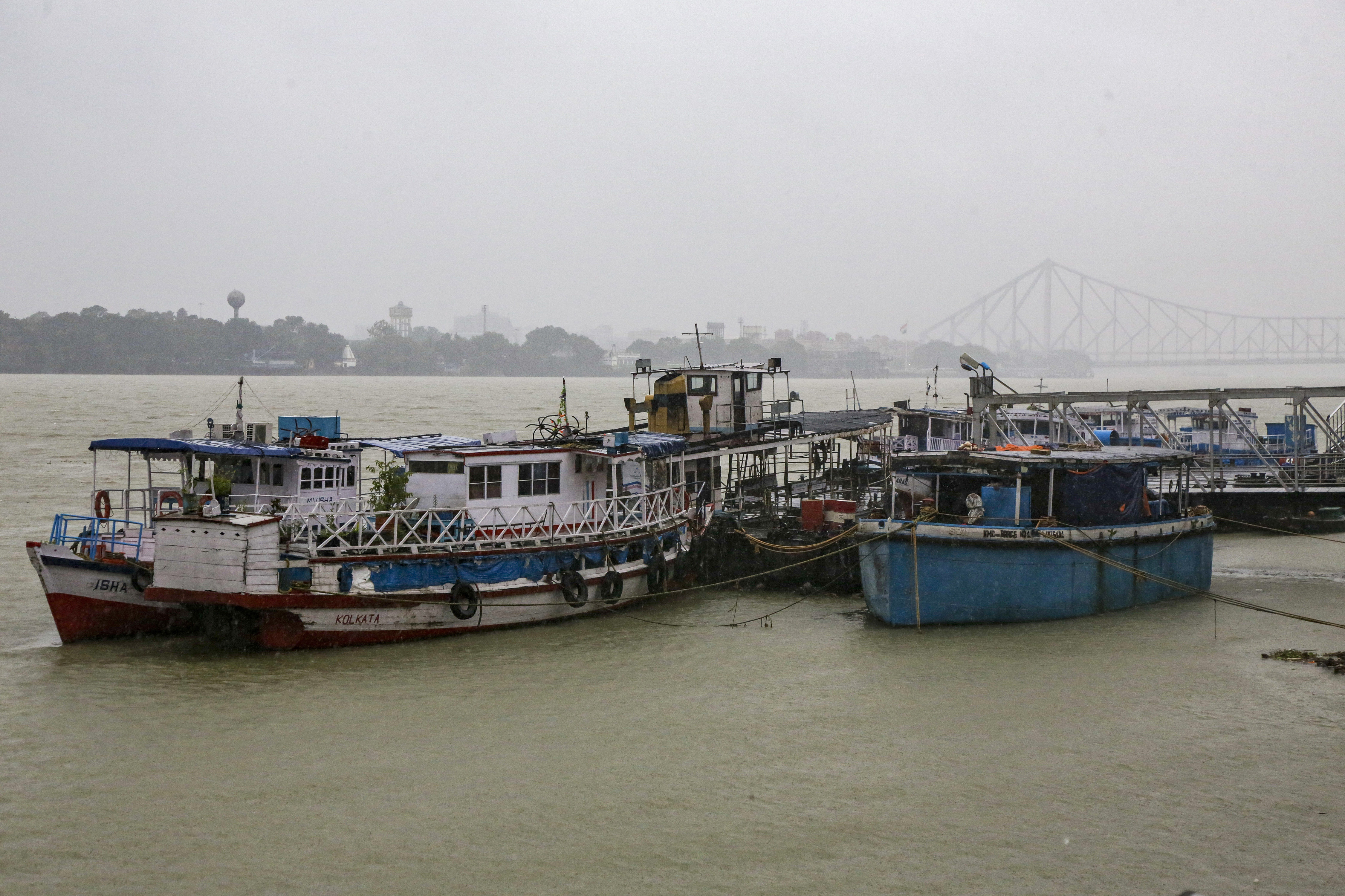 Mechanised boats and ferries stand on the Hooghly River in Kolkata, India, Saturday. Authorities in nearby Bangladesh put more than 50,000 volunteers on standby and readied about 5000 shelters as cyclone Bulbul was to hit.