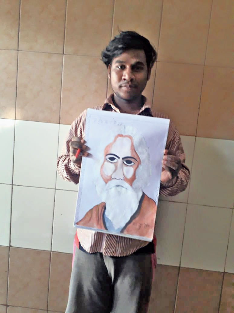 Rakesh Kumar, a hearing-impaired youth, shows a drawing of Rabindranath Tagore on the bard's 159th birth anniversary on Friday.