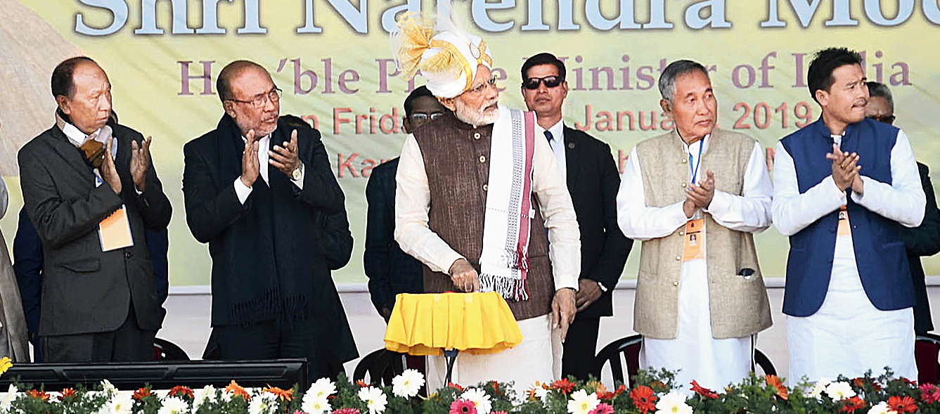 Prime Minister Narendra Modi launches the projects as Manipur chief minister N. Biren Singh and other dignitaries look on in Imphal on Friday.