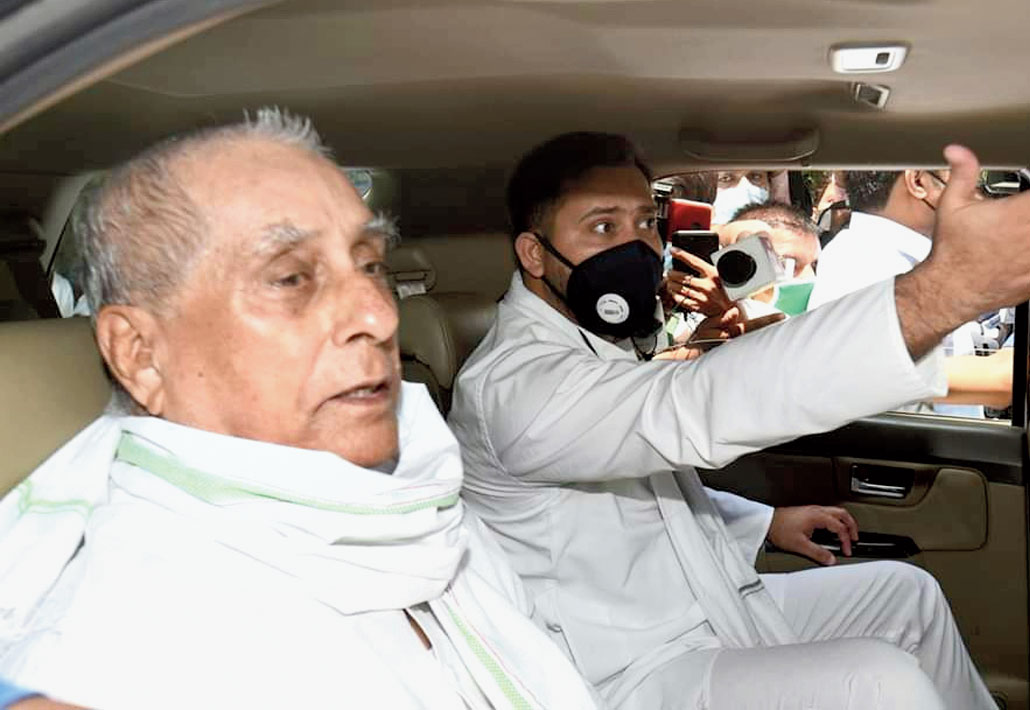 Tejashwi and RJD state president Jagadanand Singh inside their car after being stopped by the police.