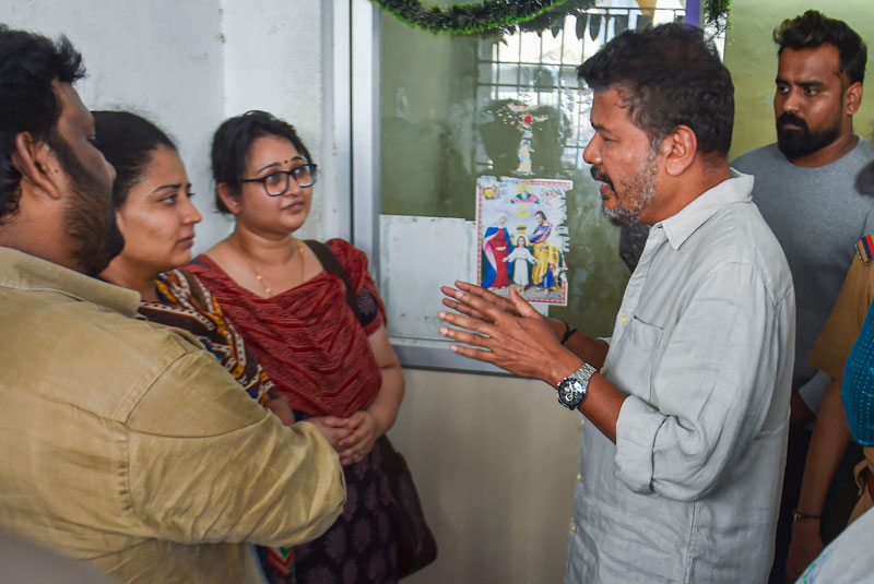 Film Director S. Shankar interacts with the daughters of cartoonist Mathan, whose son-in-law was one of the three persons who lost their lives after a crane crashed on the sets of upcoming film 'Indian 2', in Chennai