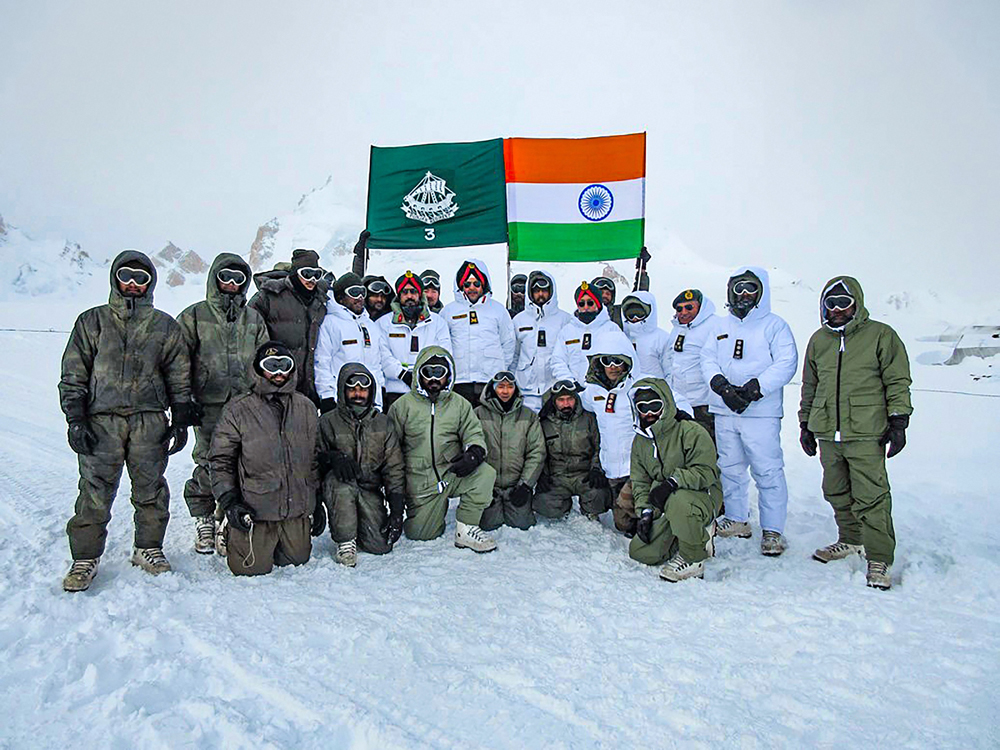 Lieutenant-general Ranbir Singh, General Officer Commanding-in-Chief, Northern Command, in a group photo with army personnel during a visit to the forward posts at Siachen on December 18