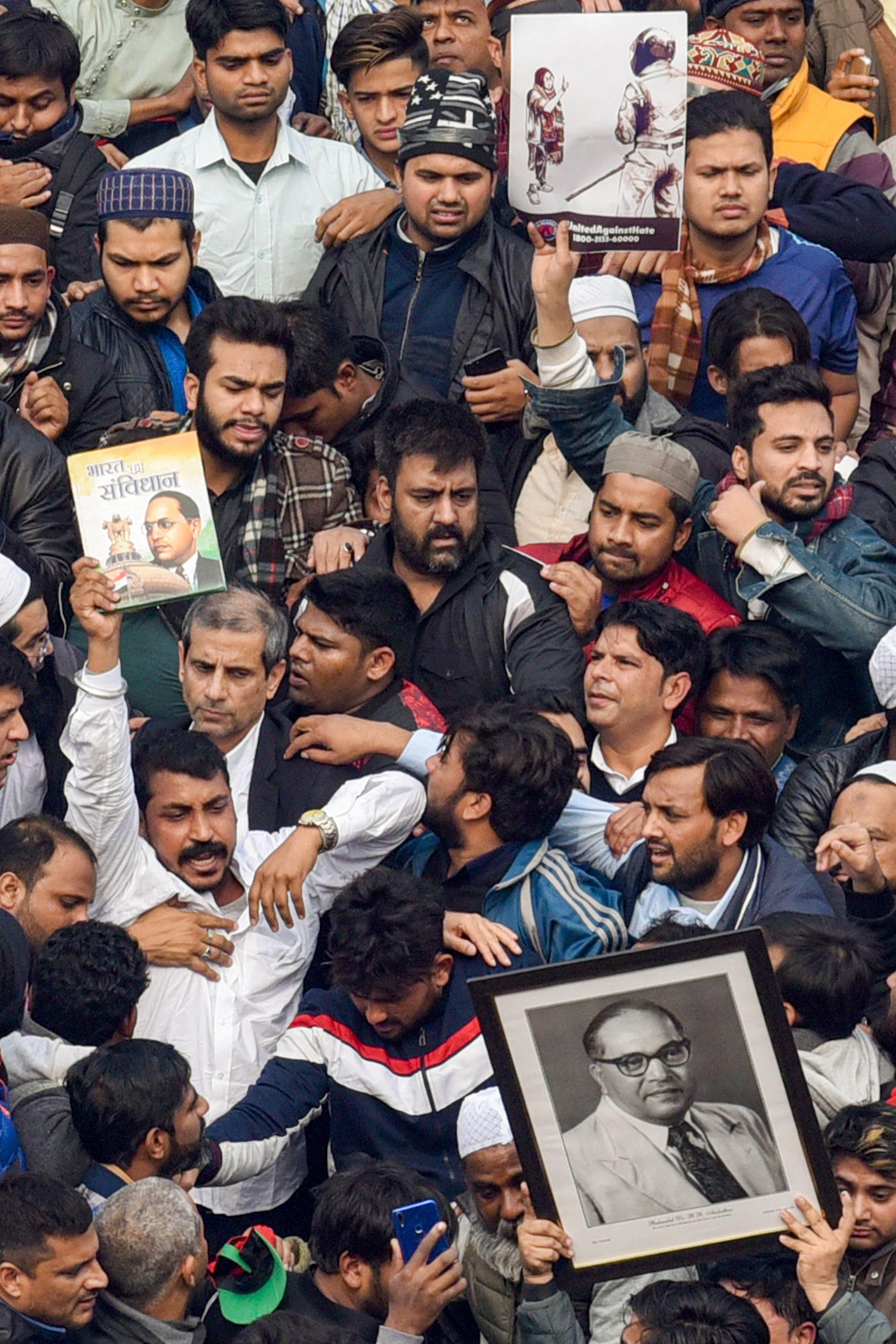 Bhim Army chief Chandrashekhar Azad raises slogans during a protest against Citizenship (Amendment) Act (CAA) at Jama Masjid in New Delhi, Friday, December 20, 2019.