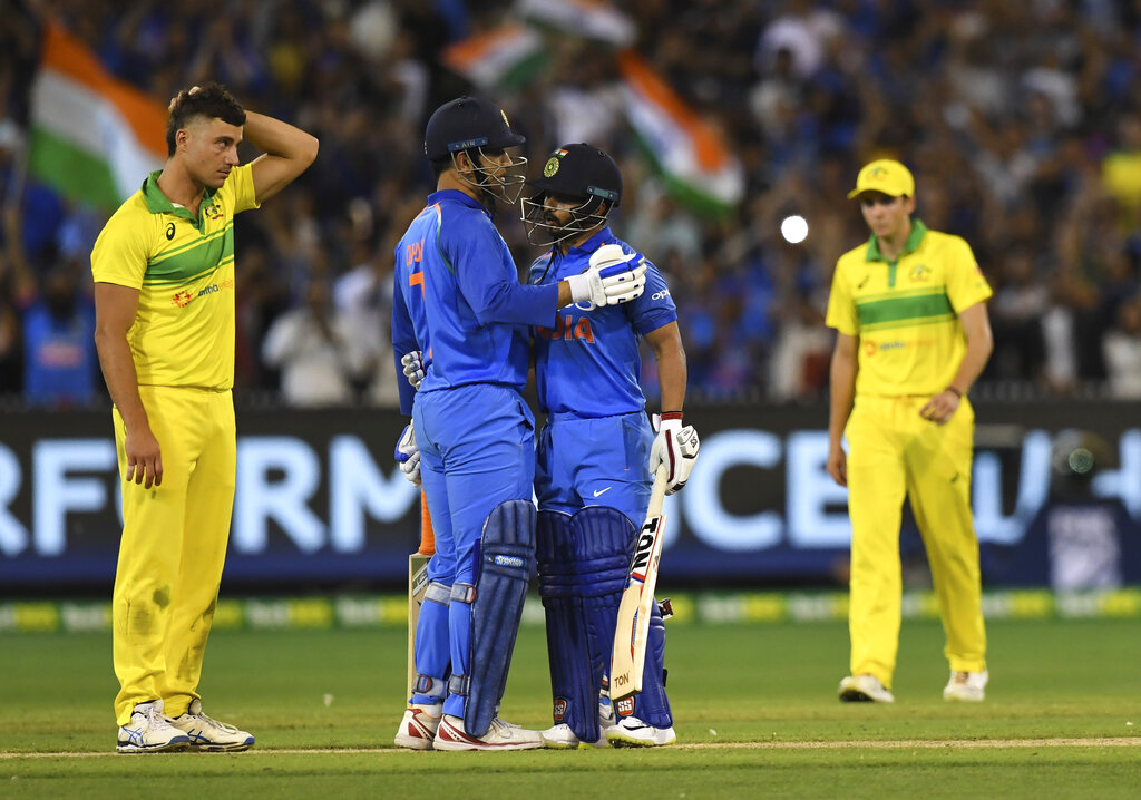 M.S. Dhoni and Kedar Jadhav congratulate each other on Friday.
