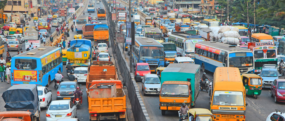 Road traffic in Bangalore. Rapid and unplanned expansion of urban space and the influx of increasing numbers of people may outpace the funds available and the speed of designing methods of safety