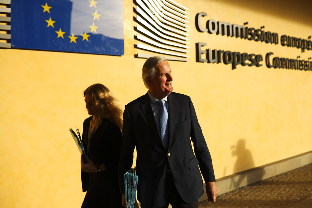 European Union chief Brexit negotiator Michel Barnier goes for a meeting on Brexit outside the EU headquarters in Brussels, Friday, October 25, 2019.