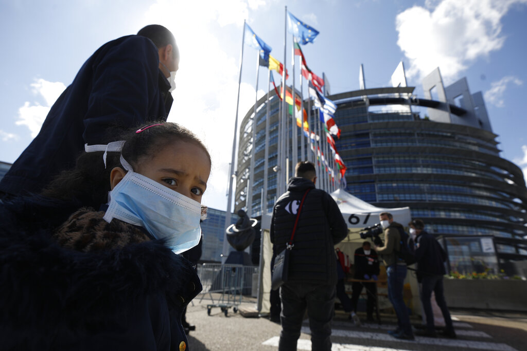 People wait in line to be tested for Covid-19 outside the European Parliament in Strasbourg, France, on May 12.  The European Union convened an international meeting to raise funds for fighting the pandemic