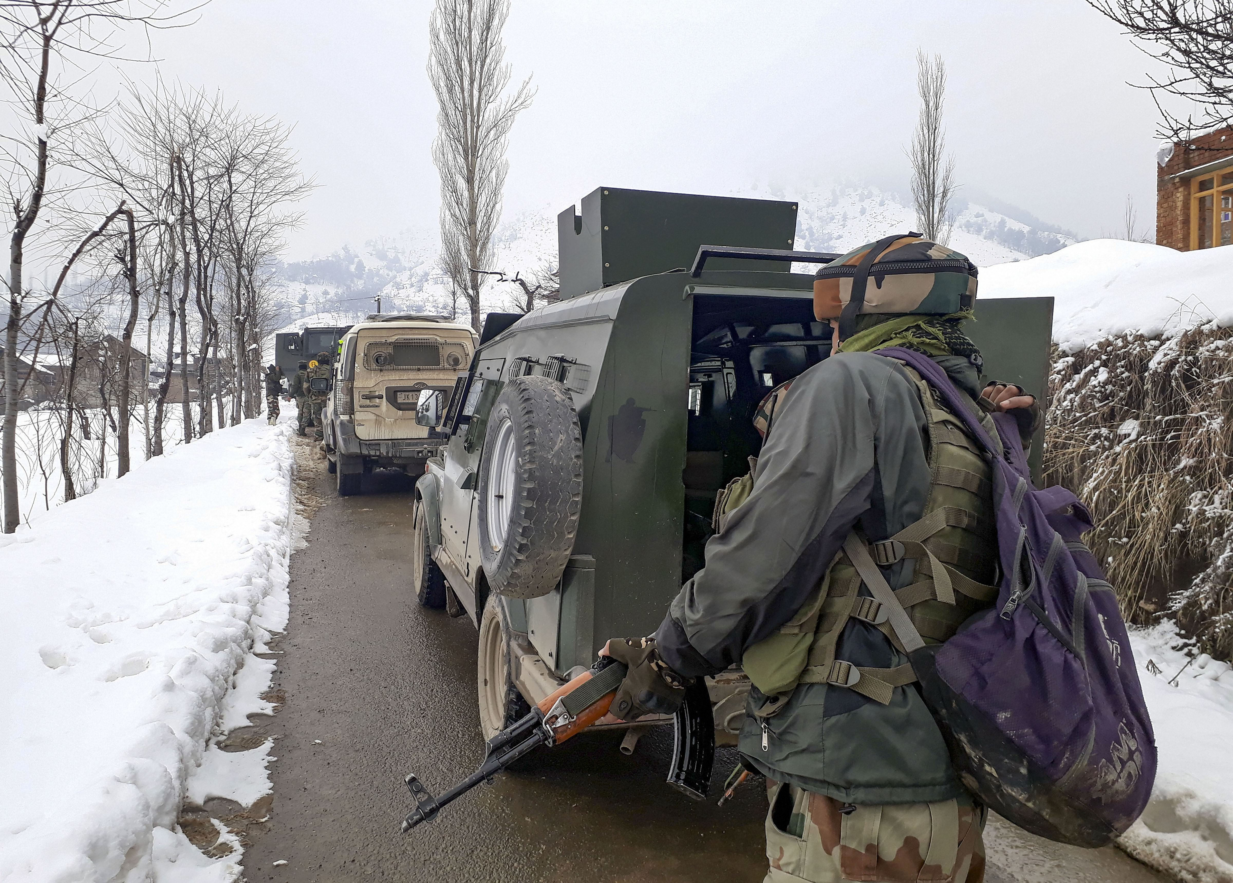 Indian Army personnel stand guard during a search and cordon operation at the Khrew area of Pulwama district in Jammu and Kashmir, Tuesday, January 21, 2020.