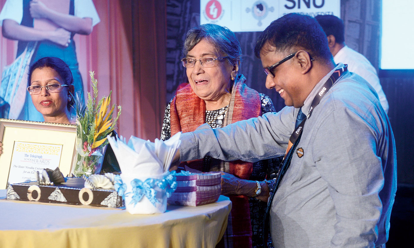 Olive Lennon cuts her birthday cake in the presence of COO Techno India Group Surojit Biswas at Nazrul Mancha on Saturday.