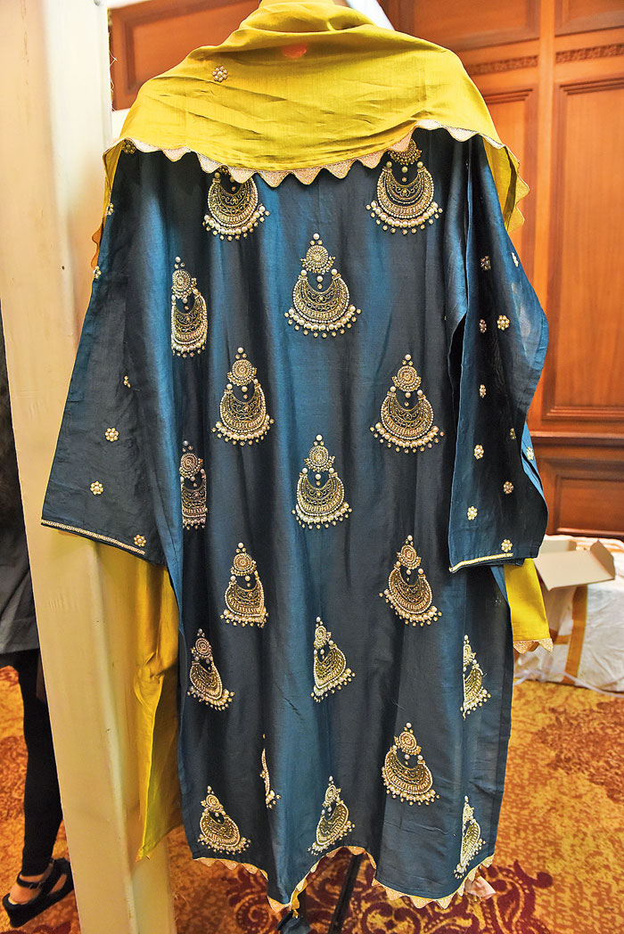 This midnight blue salwar set with pearl work and cutdana detailing has jhumka motifs for that extra dash of festivity. The lime dupatta with a scalloped border is a perfect contrast! Rs 14,500 @Vaga Fashions (contact: 97176533307)