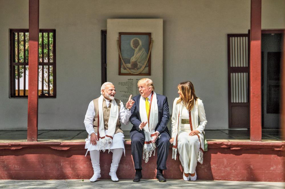 Narendra Modi, Donald Trump and Melania at Sabarmati Ashram in Ahmedabad on Monday