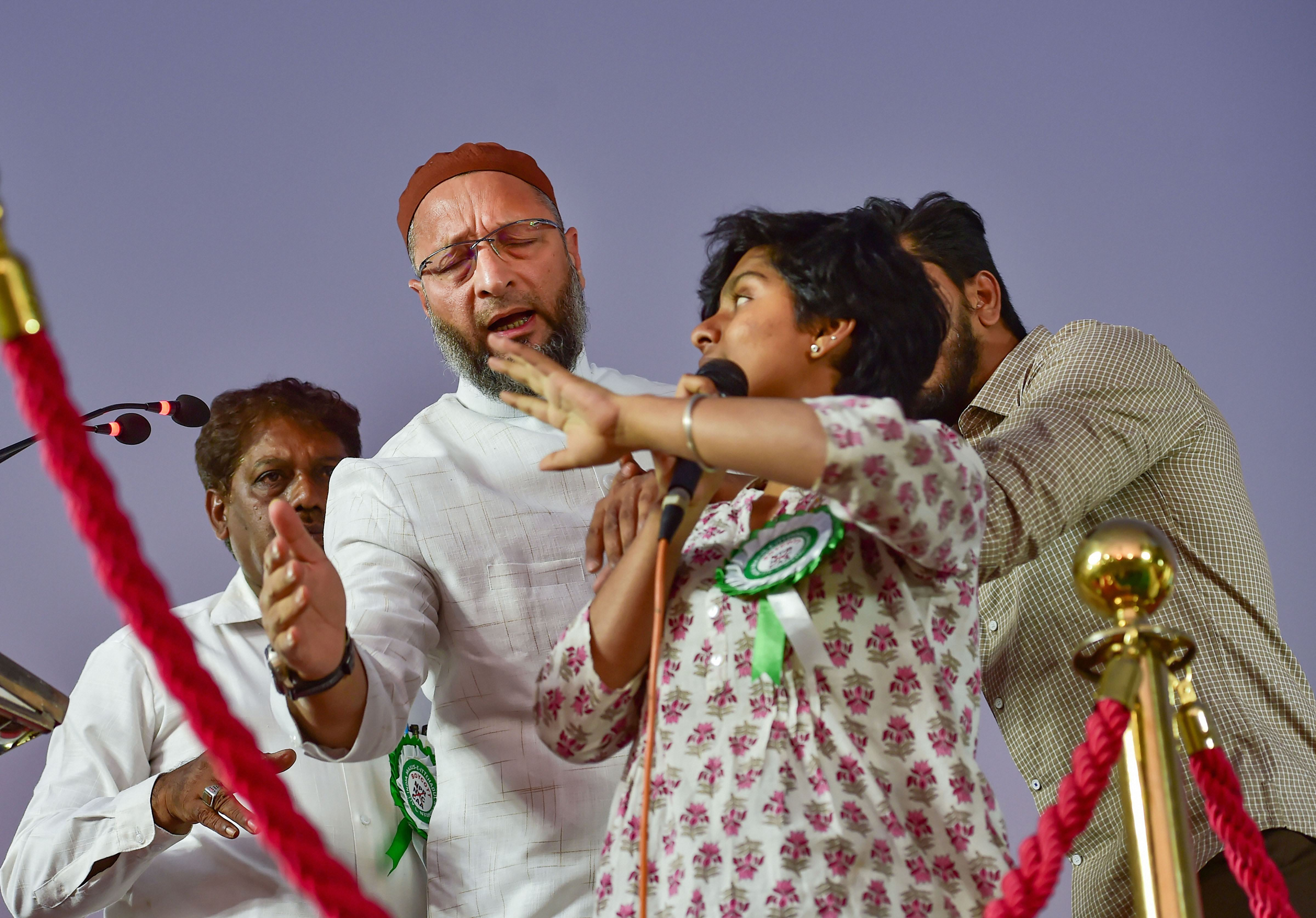 President of the AlI India MIM Asaduddin Owaisi attempts to stop an unidentified woman who allegedly raised pro-Pakistan slogans during a protest against CAA, NRC and NPR in Bengaluru, on Thursday, February 20, 2020