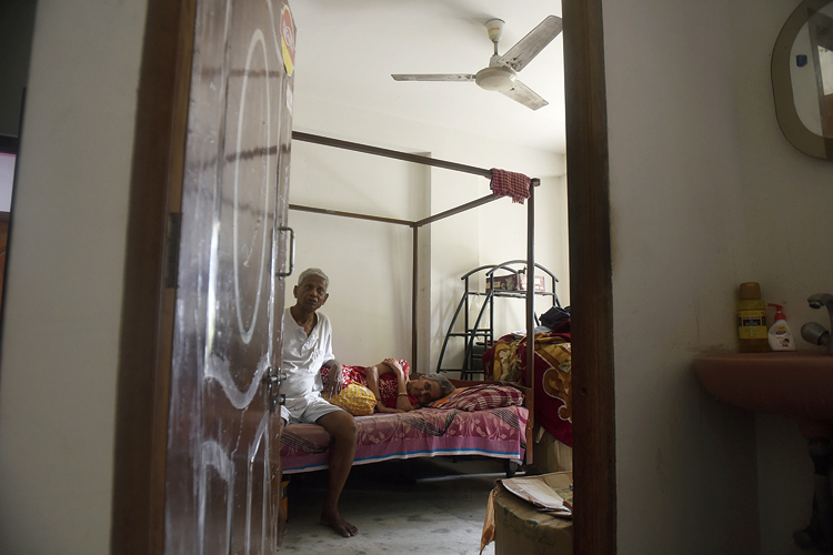 Tarun Kumar Ghosh and wife Juthika at their apartment on Biren Roy Road (West) on Wednesday.