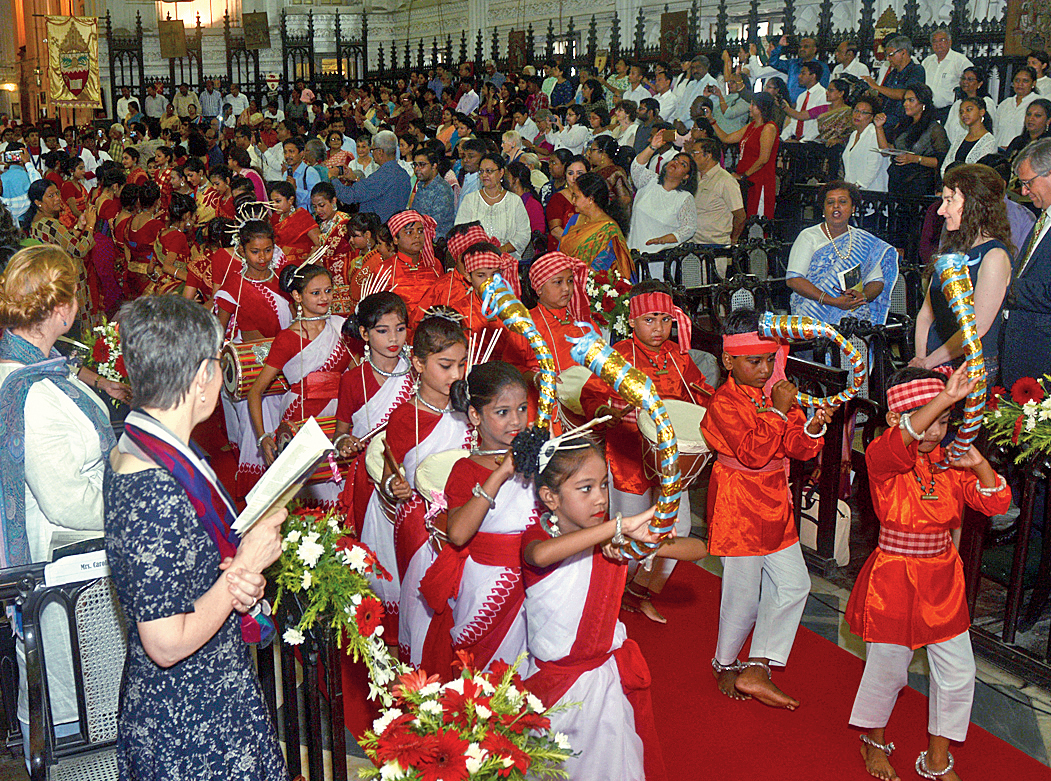 Students perform a tribal song and dance at St. Paul's Cathedral