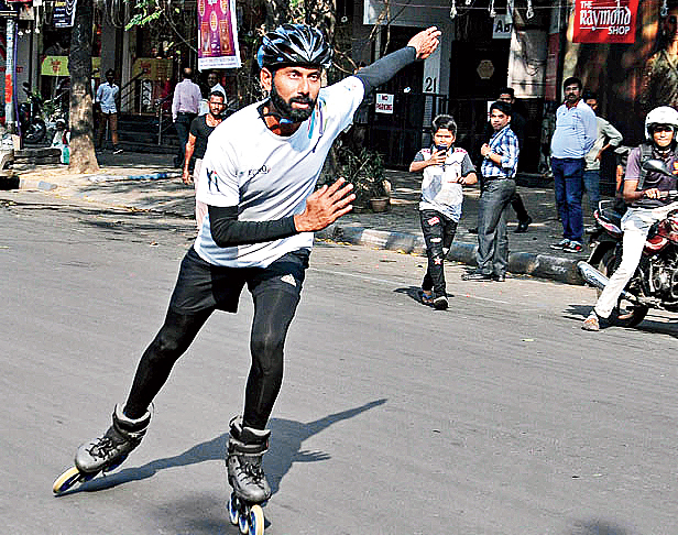 Entrepreneur and international skater Rana Uppalapati skates as a passerby takes his pictures in Calcutta.
