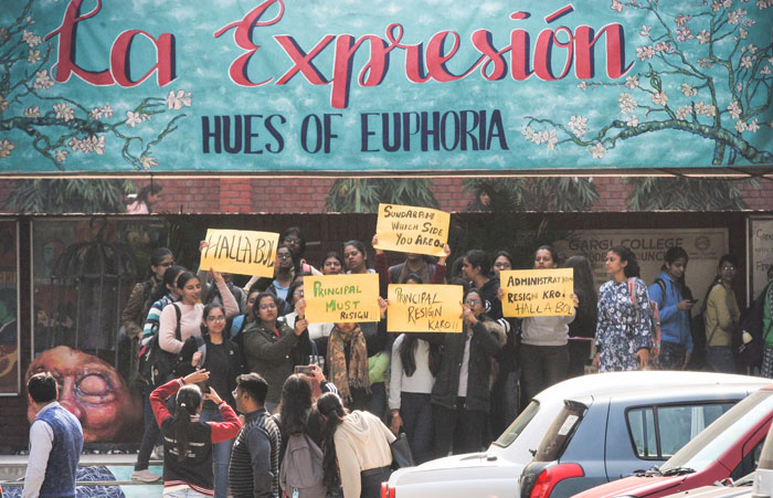 Students hold placards during a protest, against the alleged molestation of students by a group of men who had gatecrashed a cultural festival, at Gargi College, in New Delhi, Monday